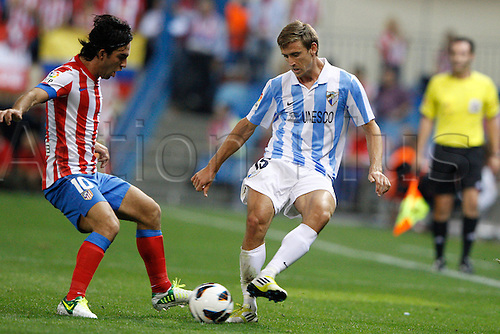 07.10.2012 Madrid, Spain  La Liga 12/13   Match played between Atletico de Madrid vs Malaga C.F. (2-1) at Vicente Calderon stadium. The picture show Nacho Monreal Eraso (Spanish defender of Malaga) and Arda Turan (Turkish midfielder of At. Madrid)