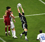 05 July 2006: Goalkeeper Fabien Barthez (FRA) (in black) claims the ball in the penalty area in front of Maniche (POR) (18). France defeated Portugal 1-0 at the Allianz Arena in Munich, Germany in match 62, the second semifinal game, in the 2006 FIFA World Cup.
