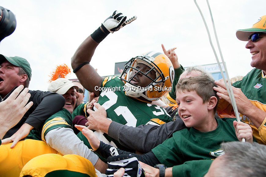 Green Bay Packers running back Brandon Jackson (32) celebrates a touchdown with a Lambeau Leap during an NFL football game against the Buffalo Bills in Green Bay, Wisconsin on September 19, 2010. The Packers won 34-7. (AP Photo/David Stluka)