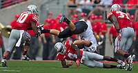Ohio State Buckeyes safety C.J. Barnett (4) makes a clean tackle on San Diego State Aztecs tight end Robert Craighead (94) during the second quarter the NCAA football game at Ohio Stadium in Columbus on Sept. 7, 2013. (Alex Holt / The Columbus Dispatch)