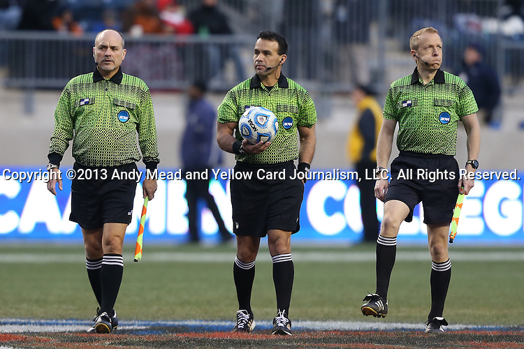 15 December 2013: Match Officials. From left: Assistant Referee Paul Scott, Referee Hilario Grajeda, and Assistant Referee Corey Rockwell. The University of Maryland Terripans played the University of Notre Dame Fighting Irish at PPL Park in Chester, Pennsylvania in a 2013 NCAA Division I Men's College Cup championship match. Notre Dame won the game 2-1.