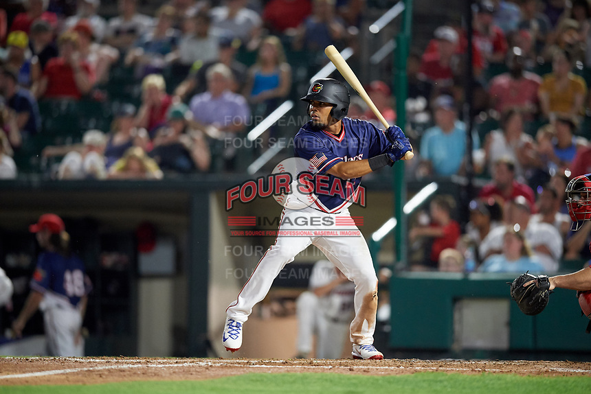 Rochester Red Wings left fielder LaMonte Wade (11) at bat during a game against the Pawtucket Red Sox on July 4, 2018 at Frontier Field in Rochester, New York.  Pawtucket defeated Rochester 6-5.  (Mike Janes/Four Seam Images)
