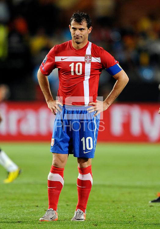 Captain Dejan Stankovic of Serbia looks dejected