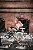 DENMARK, Copenhagen, Woman getting ready for a bike ride, Europe