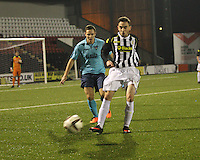 Anton Brady being closed down by Stephen Husband in the St Mirren v Dunfermline Athletic Scottish Professional Football League Under 20 match played at the Excelsior Stadium, Airdrie on 11.12.13.
