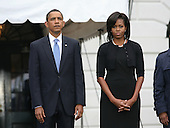 Washington, DC - September 11, 2009 -- United States President Barack Obama and first lady Michelle Obama stood for a moment of silence at 8:46am in honor of those lost during the terrorist attacks on September 11th, 2001.  Members of the White House staff were on hand for the event that was held on the South Lawn of the White House.  .Credit: Gary Fabiano - Pool via CNP