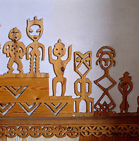 Detail of stylised figures inspired by ancient African designs