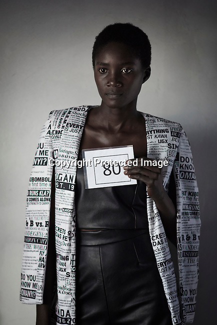 KAMPALA, UGANDA - NOVEMBER 11: Ugandan model Comfort Munduru is photographed during a fitting with the designers Definition Africa on the rooftop of the Acacia Mall one day before the Kampala Fashion Week, Uganda 2015. (Photo by: Per-Anders Pettersson)