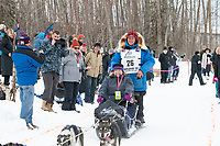 Martin Buser and team run past spectators on the bike/ski trail near University Lake with an Iditarider in the basket and a handler during the Anchorage, Alaska ceremonial start on Saturday, March 7 during the 2020 Iditarod race. Photo © 2020 by Ed Bennett/Bennett Images LLC