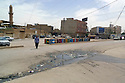 Iraq 2011 <br /> In a street of Erbil, oil drums and minaret   <br /> Irak 2011 <br /> Dans une rue d'Erbil, barils de petrole et minaret