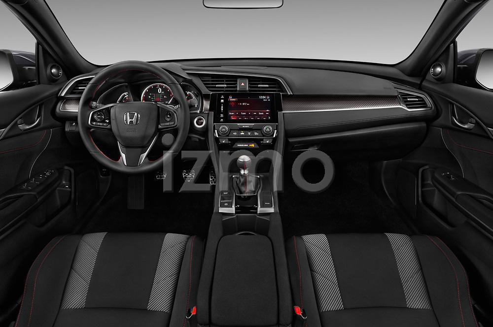 Stock photo of straight dashboard view of a 2018 Honda Civic Si 5 Door Sedan