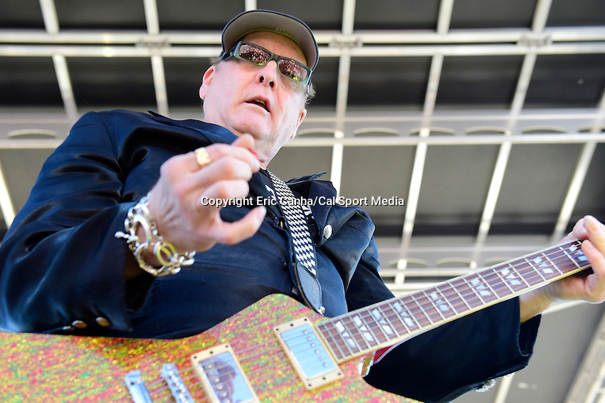 Sunday, September 25, 2016: Rick Nielsen of Cheap Trick performs for spectators before the NASCAR Sprint Cup Series Bad Boy Off Road 300 race held at the New Hampshire Motor Speedway in Loudon, New Hampshire. Sprint Cup Series driver Kevin Harvick (4) won the race. Eric Canha/CSM