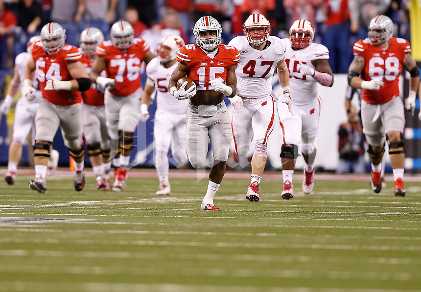 Ohio State Buckeyes running back Ezekiel Elliott (15) breaks away for a long touchdown run during the Big Ten Championship game between the Ohio State Buckeyes and the Wisconsin Badgers at Lucas Oil Stadium in Indianapolis, Saturday night, December 6, 2014. The Ohio State Buckeyes defeated the Wisconsin Badgers 59 - 0. (The Columbus Dispatch / Eamon Queeney)