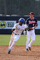 University of Kentucky Wildcats outfielder JaVon Shelby #5 running the bases during a game against the University of Virginia Cavaliers at Brooks Field on the campus of the University of North Carolina at Wilmington on February 14, 2014 in Wilmington, North Carolina. Kentucky defeated Virginia by the score of 8-3. (Robert Gurganus/Four Seam Images)