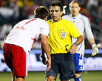 Head referee Mauricio Navarro exchanges words with NY Red Bulls defender, Andrew Boyens(27) as Chivas USA Goalkeeper, Brad Guzan(18) looks on from behind. Chivas USA  took on the NY Red Bulls on June 28, 2008 at the Home Depot Center in Carson, CA. The game ended in a 1-1 tie.