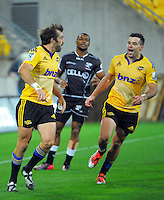 James Marshall (right) congratulates Conrad Smith on his try during the Super Rugby match between the Hurricanes and Sharks at Westpac Stadium, Wellington, New Zealand on Saturday, 9 May 2015. Photo: Dave Lintott / lintottphoto.co.nz
