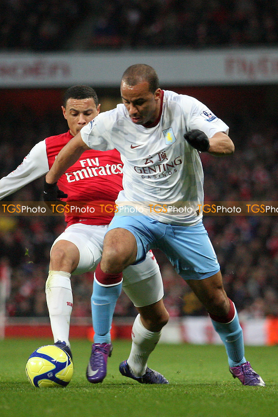 Gabriel Agbonlahor of Aston Villa and Francis Coquelin of Arsenal -  Arsenal vs Aston Villa - at the Emirates Stadium - 29/01/12 - MANDATORY CREDIT: Dave Simpson/TGSPHOTO - Self billing applies where appropriate - 0845 094 6026 - contact@tgsphoto.co.uk - NO UNPAID USE.