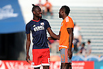 15 June 2016: New England's Kei Kamara (SLE) (13) and Carolina's James Marcelin (HAI) (42) before the game. The Carolina RailHawks hosted the New England Revolution at WakeMed Stadium in Cary, North Carolina in a 2016 Lamar Hunt U.S. Open Cup fourth round game.