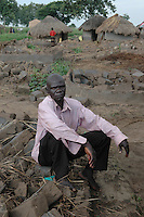 Okello Alfred is the leader of a camp of diminishing population in Lira, Northern Uganda. Many of the 40,000 residents of Agwang Camp for internally displaced have returned to their villages in the wake of the September, 2006 ceasfire between the Ugandan government and the Lord's resistance Army. The conflict with the LRA had forced as many as two million people into camps accross northern districts for as many as 20 years. The LRA and Ugandan government have  observed a ceasefire while engaged in peace talks to end the conflict. As a result many residents of camps for the internally displaced have been slowly returning to their villlages to begin again.  (Rick D'Elia)
