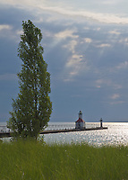 St Joseph Pier Lighthouse and Pierhed Light sits under a late afternoon summer sky awaiting a coming storm, St Joseph, Berrien County, Michigan