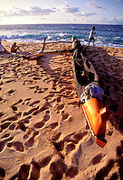A canoe rests by the shore of a sandy beach on the island of Kahoolawe.