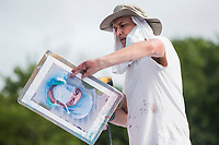 NEW YORK, NY - MAY 27: View of artist Jorge Rodríguez on May 27, 2020 in Queens, New York. The artist Jorge Rodríguez Gerada makes a stunning mural in Flushing Meadows, Corona Park to Dr. Ydelfonso Decoo, an immigrant doctor who died of complications from Coronavirus. The mural is also made in gratitude to the millions of medical workers who have given their lives to fight COVID-19. (Photo by Pablo Monsalve / VIEWpress via Getty Images)
