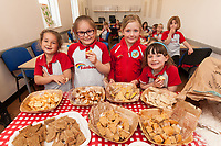 Rainbows learn to make bread at ASDA Newark - pictured from left are Evalynn Glennester, 6, Zuzanna Wrobel, 7, Esme McWilliams, 7 and Ava-May Le Mitchell, 6