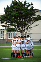The PNBHS team huddles before the 1st XI college football match between St Patrick's College (Town) College and Palmerston North Boys' High School at St Pat's College Artificial Turf, Wellington, New Zealand on Wednesday, 13 May 2015. Photo: Dave Lintott / lintottphoto.co.nz