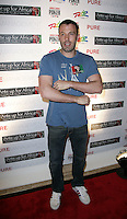 BEN AFFLECK.The Ante Up for Africa Celebrity Poker Tournament at the Rio Resort Hotel and Casino, Las Vegas, Nevada, USA..July 2nd, 2009.full length blue t-shirt arms crossed jeans denim .CAP/ADM/MJT.© MJT/AdMedia/Capital Pictures