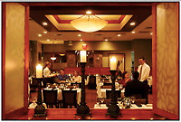 Lifestyle photography of people dining in Dressler's Restaurant, an upscale restaurant located mixed-use development Birkdale Village. The suburban shopping center is located in Huntersville, NC, a few miles north of Charlotte, NC.  Birkdale Village is one of the country's first mixed-use developments. The center, anchored by shopping and restaurants, was developed by Pappas Properties.