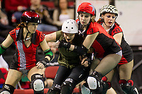 Seattle's Rat City Rollergirls compete against Portland's Rose City Rollers in their second bout of the season at Key Arena in Seattle, WA on Saturday, February 19, 2011.