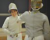 Lauren Cappello of Ward Melville, left, shakes hands with Amber Patrick of Jericho after their sabre bout in the girls fencing Long Island Championship at Jericho High School on Tuesday, Feb. 6, 2017. Cappello won all three of her bouts to lead the Patriots to a 14-7 win.