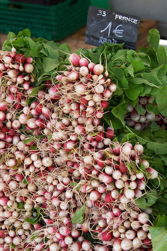 Radishes On a street market. On Les Quais. Bordeaux city, Aquitaine, Gironde, France