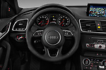 Car pictures of steering wheel view of a 2018 Audi Q3  2.0T-FWD-tiptronic-Premium-Plus  5 Door SUV