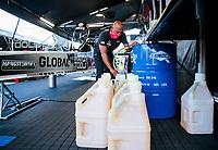 Jul 19, 2020; Clermont, Indiana, USA; NHRA top fuel driver Antron Brown prepares nitromethane racing fuel during the Summernationals at Lucas Oil Raceway. Mandatory Credit: Mark J. Rebilas-USA TODAY Sports