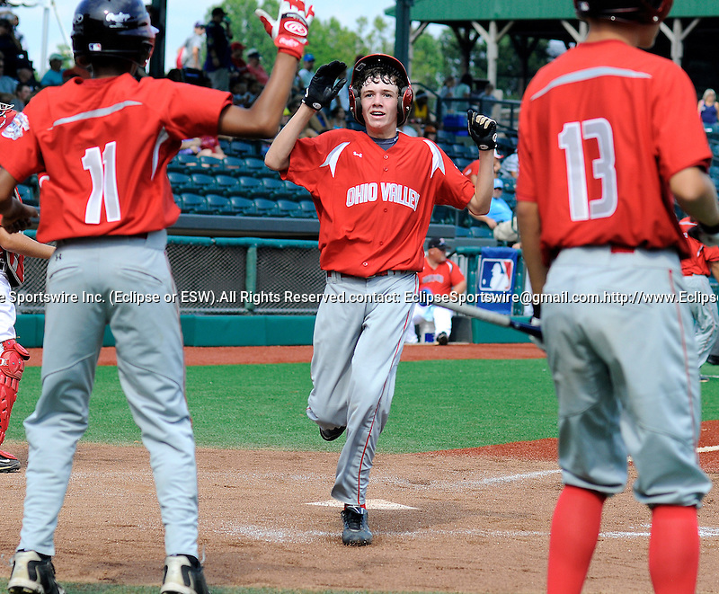 Austin Dick is congratulated by teammates after scoring a run at the Cal Ripken World Series in Aberdeen, Maryland on August 19, 2011