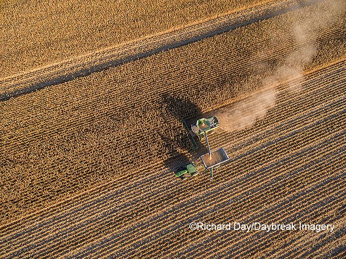 63801-08316 Corn Harvest, John Deere combine unloading corn into grain cart while harvesting - aerial Marion Co. IL