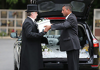 Pictured: The coffin carrying baby Sion is taken inside Briwnant Chapel at Thornhill Cemetery, Cardiff, Wales, UK. Tuesday 28 June 2016<br /> Re: The funeral of Sion, the baby boy found dead in the River Taff in Cardiff has taken place<br /> Generous locals raised nearly &pound;1,400 for the memorial after reading about plans to hold a fitting ceremony for the newborn baby whose body was discovered in Cardiff a year ago.<br /> The funeral took place at the Briwnant Chapel at Thornhill Crematorium, Cardiff. Members of the public are invited to be among the congregation.