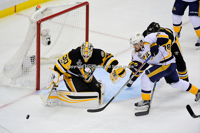 June 8, 2017: Nashville Predators right wing Viktor Arvidsson (38) battles in front of Pittsburgh Penguins goalie Matt Murray (30) for a shot on goal during game five of the National Hockey League Stanley Cup Finals between the Nashville Predators  and the Pittsburgh Penguins, held at PPG Paints Arena, in Pittsburgh, PA. Eric Canha/CSM