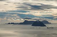Islands of Værøy rise from the sea, Lofoten Islands, Norway