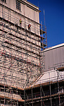 A3A8K9 Demolition scaffolding old industrial buildings being demolished Ipswich Wet Dock Suffolk England. Image shot 2006. Exact date unknown.