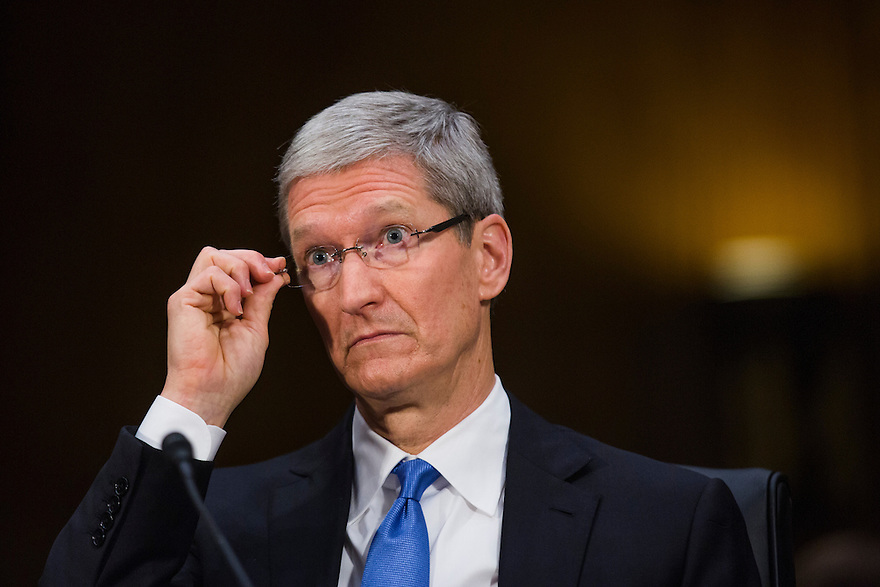 Apple CEO Tim Cook testifies at a Senate homeland security and governmental affairs investigations subcommittee hearing on offshore profit shifting and the U.S. tax code, on Capitol Hill in Washington. Cook defended the company's tax record during a Senate hearing where lawmakers said the maker of iPads, iPods and Mac computers kept billions of dollars in profits in Irish subsidiaries to avoid U.S. taxes.