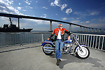 SAN DIEGO, CA - JULY 22:  Helmut Werb poses with a Harley Davidson Fatboy in front of the Coronado Bridge during the Harley Davidson Release test ride for Stern Magazine on July 22 in San Diego, California. (Photo by Donald Miralle) *** Local Caption *** Helmut Werb