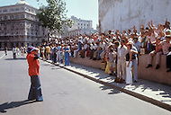 June, 1977. Havana, Cuba. Eighteen years after the Cuban Revolution the first U.S. tourists were permitted to visit Havana. Tourists taking pictures of the friendly Cuban crowd. Many Cubans gathered in hopes of being photographed for publication for their families in the U.S.
