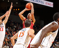 Dec. 30, 2010; Charlottesville, VA, USA; Iowa State Cyclones guard Diante Garrett (10) shoots over Virginia Cavaliers guard Billy Baron (15) and Virginia Cavaliers guard Sammy Zeglinski (13) during the game at the John Paul Jones Arena. Mandatory Credit: Andrew Shurtleff