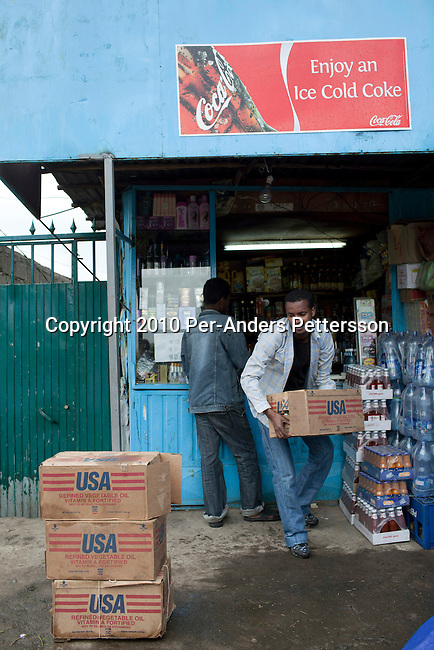 ADDIS ABABA, ETHIOPIA - NOVEMBER 14 : A shop owner places boxes with cans of U.S cooking oil outside his shop on November 14, 2010 in central Addis Ababa, Ethiopia. The oil is given out for free as Aid, but it is often sold in shops around the country. (Photo by: Per-Anders Pettersson)