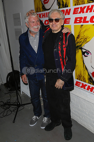 New York, NY - September 22 : Musician Chris Stein and Guest attend Blondie's 40th Anniversary Exhibition Hosted by Jeffrey Deitch held at the Chelsea Hotel Storefront Gallery on September 22, 2014 in New York City. (Photo by Brent N. Clarke / MediaPunch)
