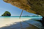 Beneath a limestone undersut on an idyllic white sand beach, Namatota Strait, Kaimana area, Papua