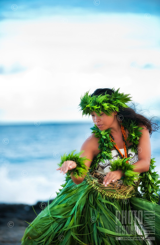 Kahiko hula dancer dancing in the old style on an east side beach, Island of Oahu