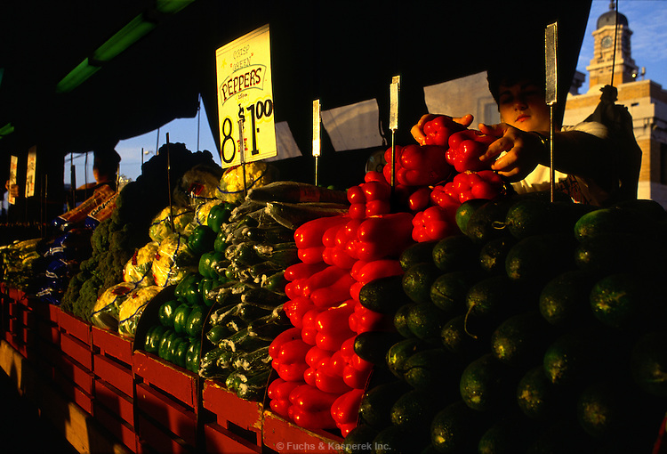 A vendor tends to his produce at Clevelands famous West Side Market.
